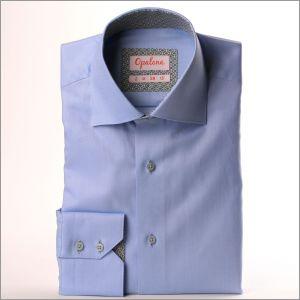 Chemise bleu à col et poignets à losanges gris