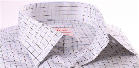 Chemise blanche à carreaux bleus