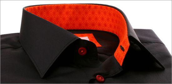 Chemise noire à col et poignets à motifs étoiles oranges